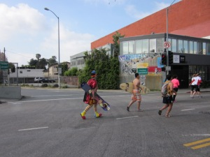 They ran the entire race carrying a surfboard and skateboard while wearing clown shoes