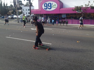 Skateboarder and runners enjoying the open streets--what could be better?