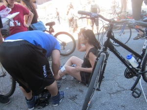 Angel administers aide to a fallen cyclist
